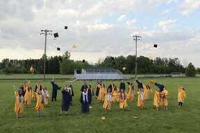 North Huron's Class of 2020 celebrated its graduation by having a parade through Kinde on Friday night. It was followed by throwing their caps and posing for photos at the North Huron High School's athletic field.