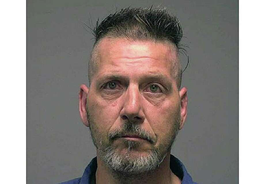 Walter Reid, 53, of New Haven, Conn., was charged with driving under the influence of liquor or drugs. Additional charges are pending, police said. Photo: Contributed Photo / New Haven Police Department
