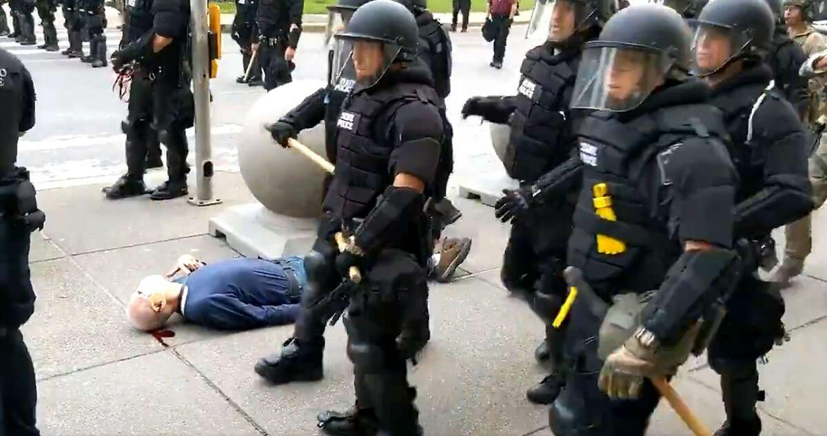 In this still images courtesy of National Public Radio (NPR) television station WBFO and taken by Mike Desmond, a 75-year-old protester bleeds from his ear after being shoved by Buffalo, New York, police, on June 4, 2020, after Buffalos curfew went into effect, according to media reports. - The protester was reported to be in stable but serious condition at a local hospital, according to NPR WBFO on June 5. (Photo by Mike Desmond / WBFO NPR / AFP) / RESTRICTED TO EDITORIAL USE - MANDATORY CREDIT