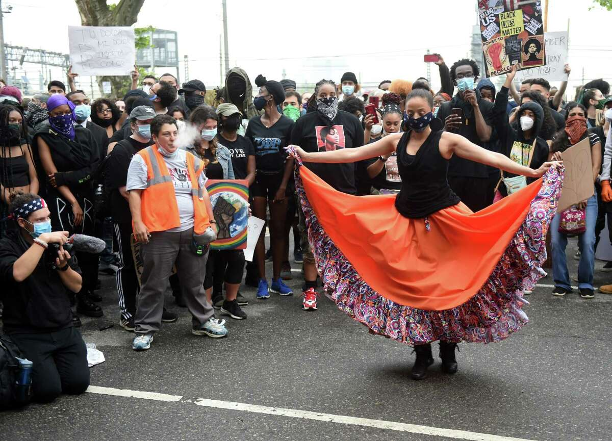 Protesters take turns dancing to African drumming at the end of a protest against police brutality and the killing of George Floyd organized by the Citywide Youth Coalition and Black Lives Matter New Haven in front of the New Haven Police Department on June 5, 2020.