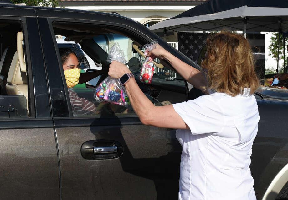 Local agencies gathered to hand out items at Uni-Trade Stadium, Friday, Jun 5, 2020, as Laredoans drive by during the Laredo Unity Parade. Photo: Danny Zaragoza/Laredo Morning Times