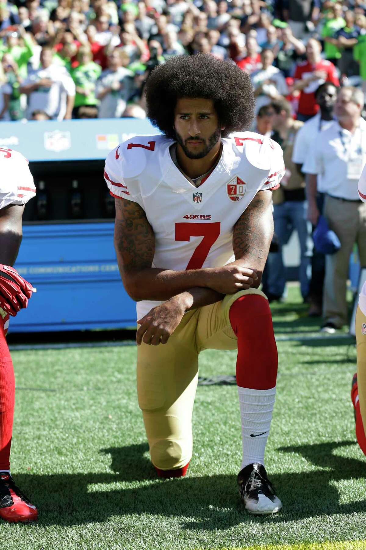 FILE - In this Sept. 25, 2016, file photo, San Francisco 49ers' Colin Kaepernick kneels during the national anthem before an NFL football game against the Seattle Seahawks, Sunday, Sept. 25, 2016, in Seattle. When Colin Kaepernick took a knee during the national anthem to take a stand against police brutality, racial injustice and social inequality, he was vilified by people who considered it an offense against the country, the flag and the military. Nearly four years later, it seems more people are starting to side with Kaepernicka€™s peaceful protest and now are calling out those who dona€™t understand the intent behind his action. (AP Photo/Ted S. Warren, File)