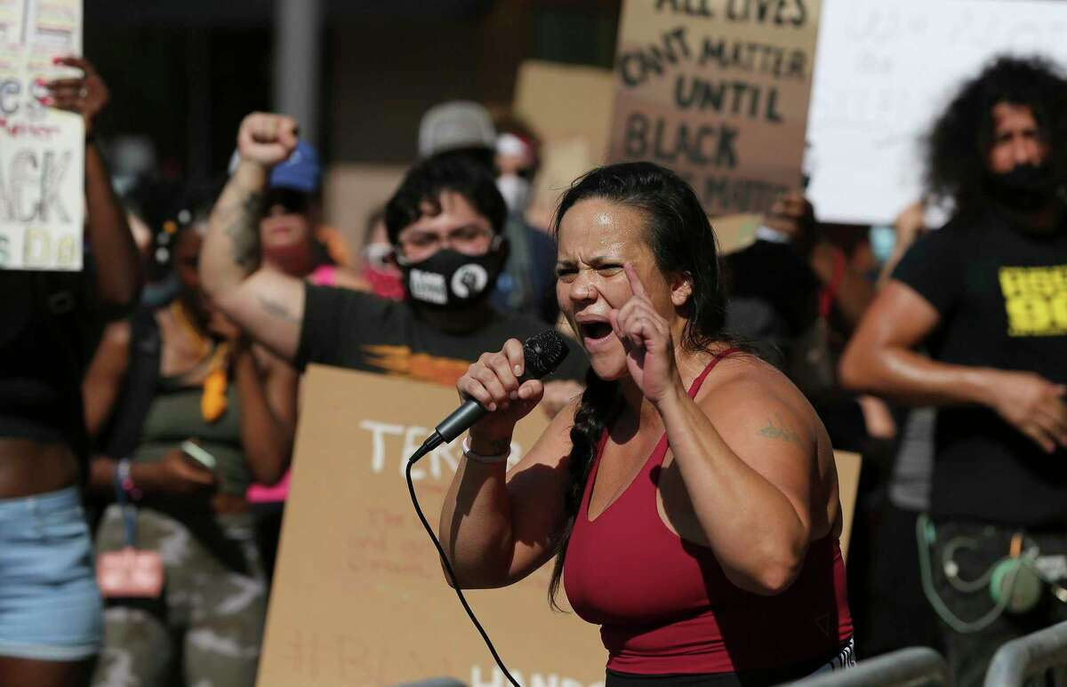 Jolene Garcia makes an impassioned speech as protestors gather at the Bexar County Courthouse on Friday. The death of an African-American man at the hands of Minneapolis police last week has sparked national outrage and protests against racial inequality and police violence.