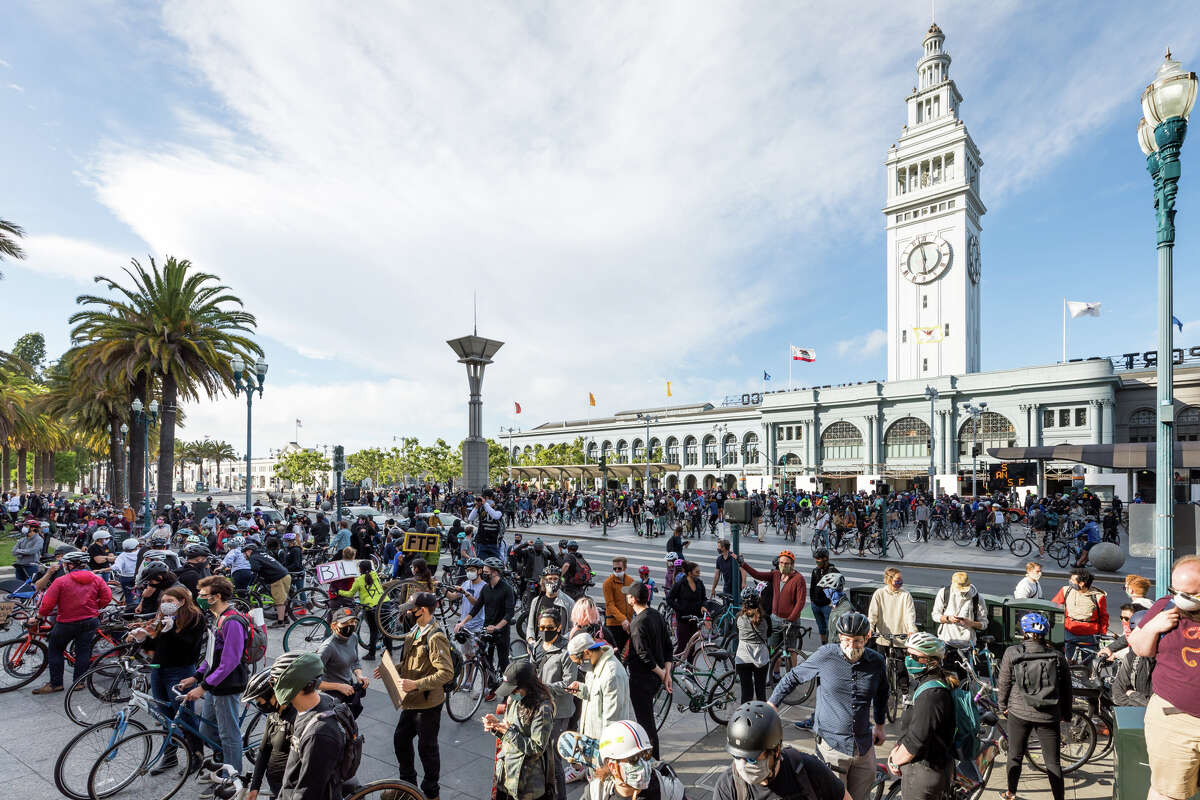 Hordes of protesters poured into Embarcadero Plaza from every direction, with masks on, Black Lives Matter signs taped to their jackets, and bicycles, skateboards and scooters fashioned into billboards for a cause to call for equality.