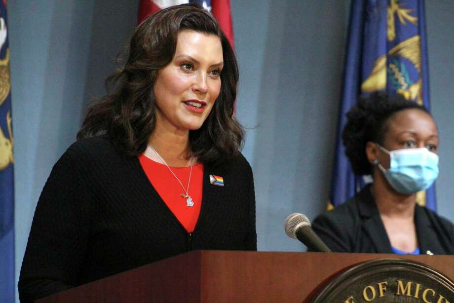 In this Friday, June 5, 2020 photo provided by the Michigan Office of the Governor, Michigan Gov. Gretchen Whitmer speaks in Lansing, Mich. Gov. Whitmer said Friday that barbershops and other personal-care businesses can reopen across Michigan on June 15, while those businesses and places like gyms and movie theaters that were shut down for months to curb the coronavirus can restart in northern Michigan next week. (Michigan Office of the Governor via AP, Pool) / Pool Michigan Office of the Governor