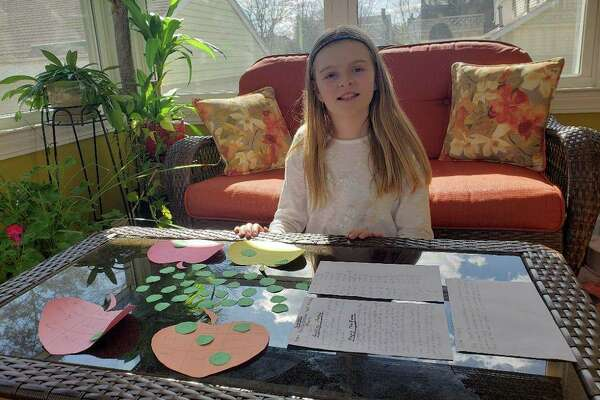 """Julia Oracz, a Marvin School fifth-grader, created a game called """"Apple Multiplication and Fractions Game."""""""