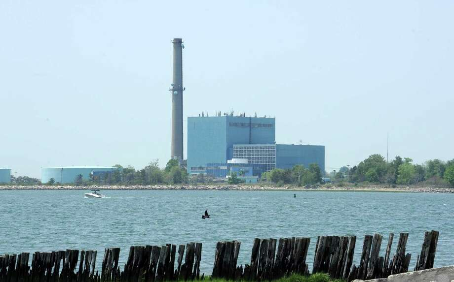 The now-defunct Manresa Island power plant in Norwalk, Conn. as seen from Calf Pasture Beach in 2016. Photo: File Photo / Connecticut Post