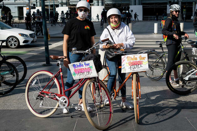"""We're big cyclists, and when we heard the cycling community was doing this we knew we had to be here,"" said Asia R. of Mountain View. Zip-tied to her bike read a sign that said ""Justice for George Floyd."" Photo: Patricia Chang/Special To The SFGATE / Special to the SFGATE"