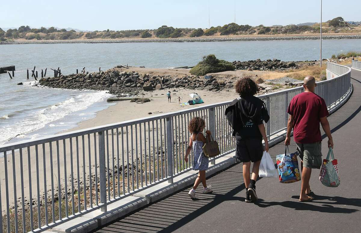 Pedestrians use the new extension of the San Francisco Bay Trail seen on Tuesday, June 2, 2020, in Albany, Calif.