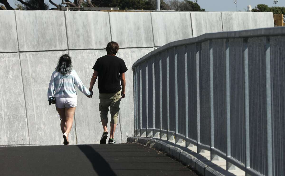 A couple hikes the new extension of the San Francisco Bay Trail seen on Tuesday, June 2, 2020, in Albany, Calif.