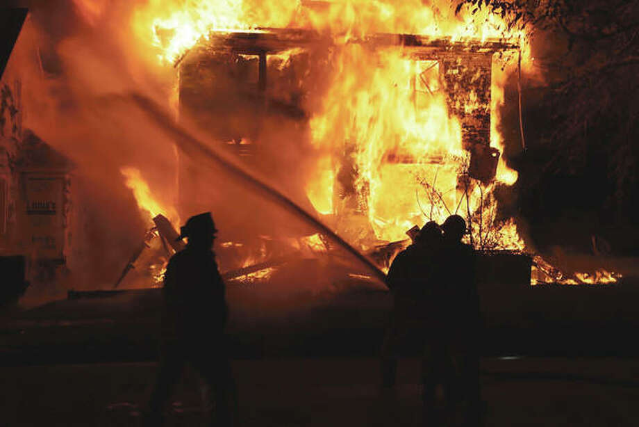 Beardstown and Arenzville firefighters battle a blaze May 28 at an abandoned residence. Photo: Photo | Brian Deloche