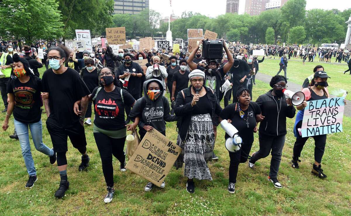 Members of the Citywide Youth Coalition lead a march protesting police brutality and the killing of George Floyd organized with Black Lives Matter New Haven starting on the New Haven Green and going to the New Haven Police Department on June 5, 2020.