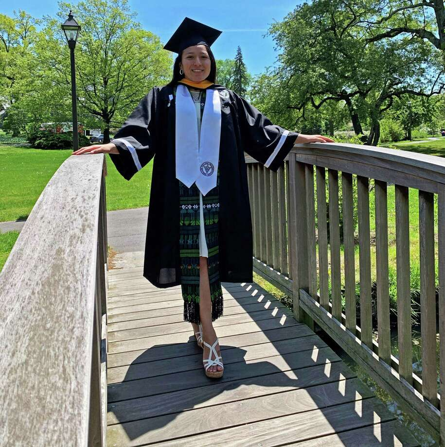 Stamford resident Katherine Uchupailla poses in her cap and gown at Binney Park in Greenwich while celebrating her graduation from Providence College in May 2020. Photo: Contributed Photo