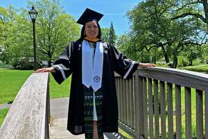 Stamford resident Katherine Uchupailla poses in her cap and gown at Binney Park in Greenwich while celebrating her graduation from Providence College in May 2020.