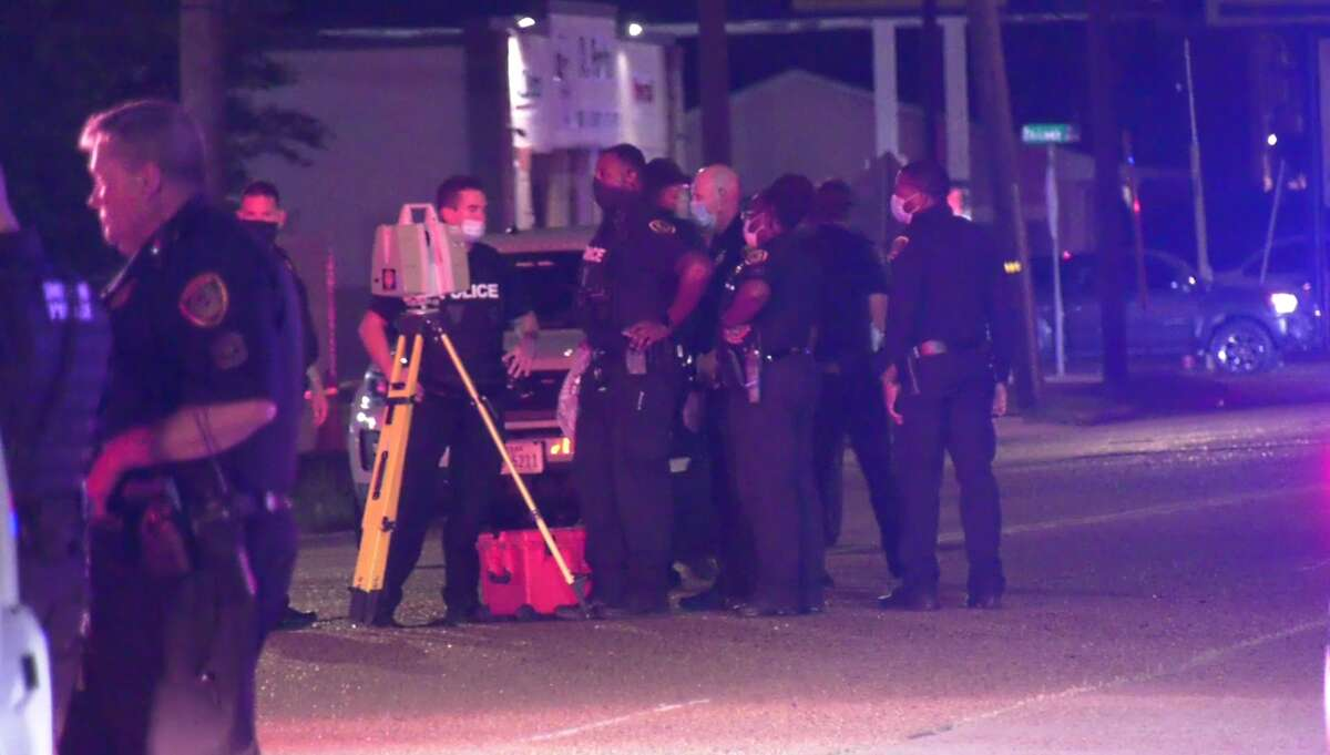 Houston police gather to investigate a fatal collision between a motorcycle and car in southeast Houston. It was one of the four deadly crashes in six hours Friday night.