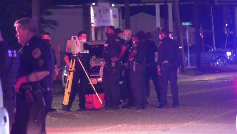 Houston police gather to investigate a fatal collision between a motorcycle and car in southeast Houston. It was one of the four deadly crashes in six hours Friday night. Photo: On Scene