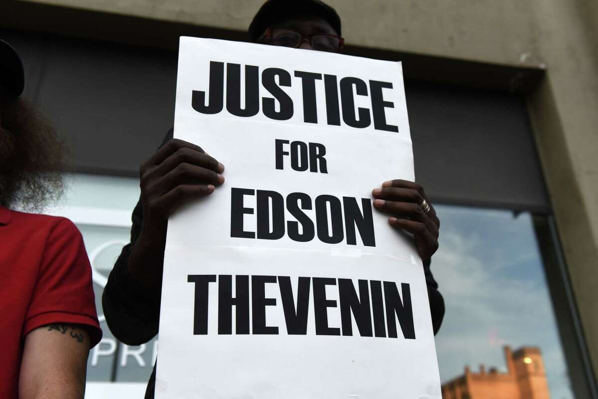 Activists gather outside Troy City Hall to protest the death of Edson Thevenin on Thursday, Sept. 5, 2019, in Troy, N.Y. Thevenin, an unarmed DWI suspect, was fatally shot by Troy police Sgt. Randall French during a traffic stop in 2016. (Will Waldron/Times Union)