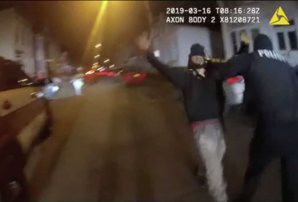 Police body camera footage shows Albany Police Officer Luke Deer taking down Armando Sanchez during a March 16, 2019, altercation on First Street. Officer Deer was charged with felony assault and a misdemeanor count of official misconduct. (Albany Police)