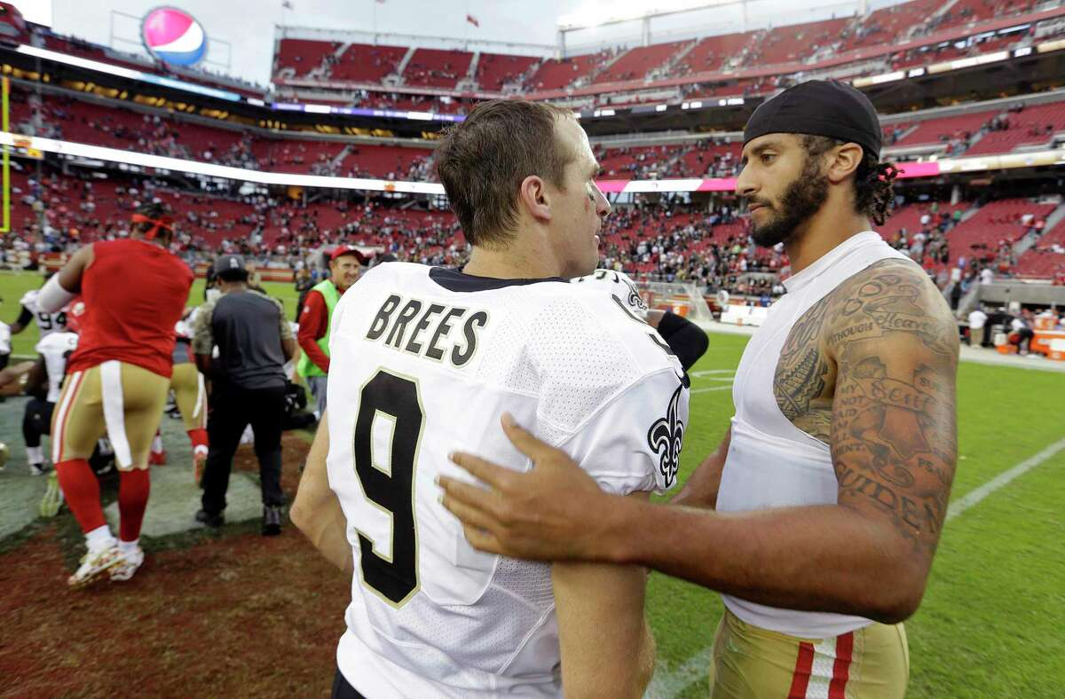 As athletes and sports organizations around the world speak out against racial injustice in the wake of George Floyd's death, Drew Brees drew sharp criticism after he reiterated his opposition to Colin Kaepernick's kneeling during the national anthem in 2016. The two QBs are shown after a game in 2016.