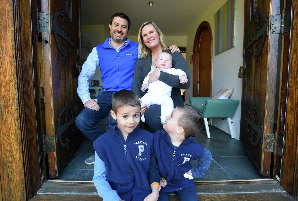 The Savov family, Stefan, Sara, Sandy (4-months), Stewart, 6, and Scott, 3, are photograph on April 16, 2020 at their home in Greenwich, Connecticut. Savov and other families are leading an effort to bring back preschool at Parkway School. The parents were abruptly told in February that the school would no longer be operating via phone call. But it's the only preschool near these backcountry residents, who either have to pay $15,000-$30,000 a year for a closer private preschool or drive 40 minutes each way to get to North Street School, where the new class is.