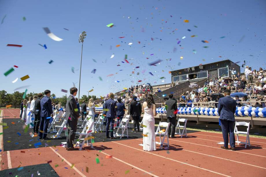 Seniors graduate Saturday, June 6, 2020 at Coombes Field at Trinity School. Photo: Jacy Lewis/Reporter-Telegram / Jacy Lewis/Reporter-Telegram
