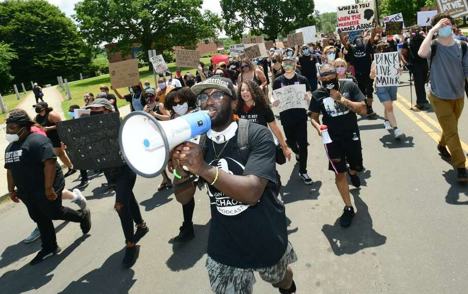 Protesters marched against police brutality and racism in Danbury, Conn., on Saturday, June 6, 2020. Photo: Erik Trautmann / Hearst Connecticut Media