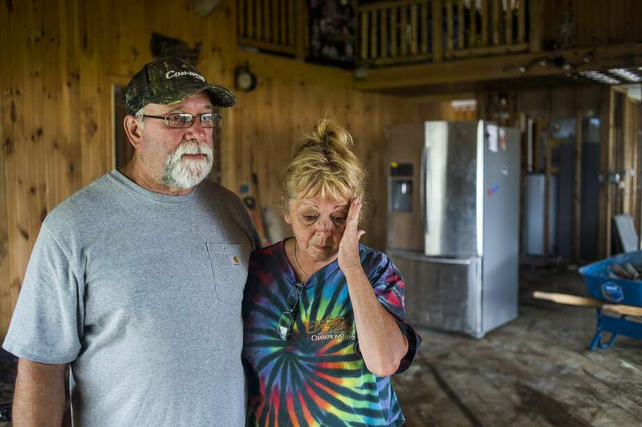 Larry and Rochelle Phillips pose for a portrait in their home on N. Verity Road as volunteers from Samaritan's Purse assist them Friday, June 5, 2020 in stripping the structure of building materials damaged by flooding. (Katy Kildee/kkildee@mdn.net) Photo: (Katy Kildee/kkildee@mdn.net)