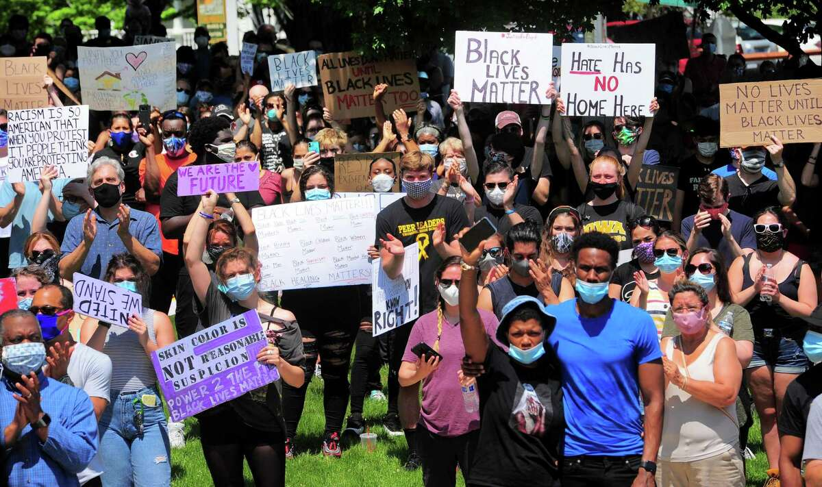 Over 1000 people gathered to protest police brutality and hear calls for peace among deepening racial tensions in the aftermath of the death of George Floyd in police custody in Minneapolis during a rally held on the Trumbull Green in Trumbull, Conn., on Saturday, June 5, 2020.