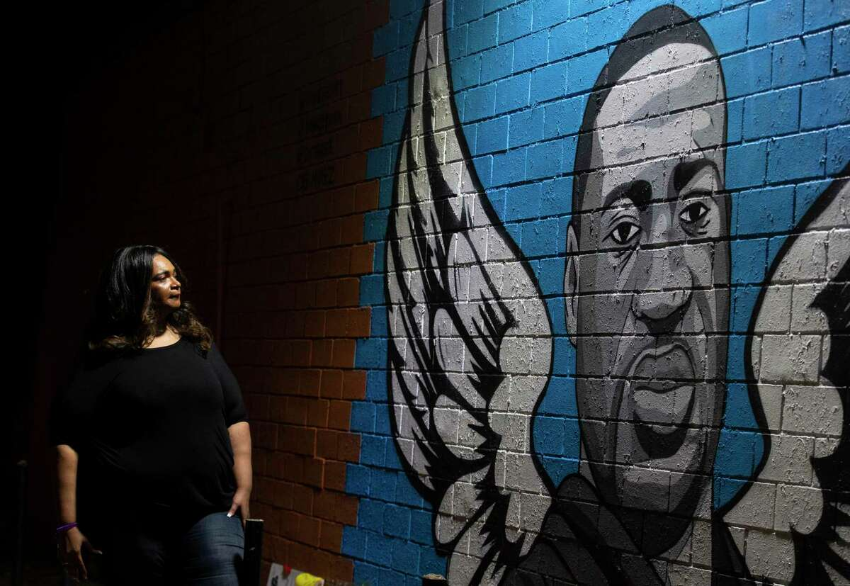 Tiffany Cofield visits the mural honoring former Houston resident George Floyd in the Third Ward.