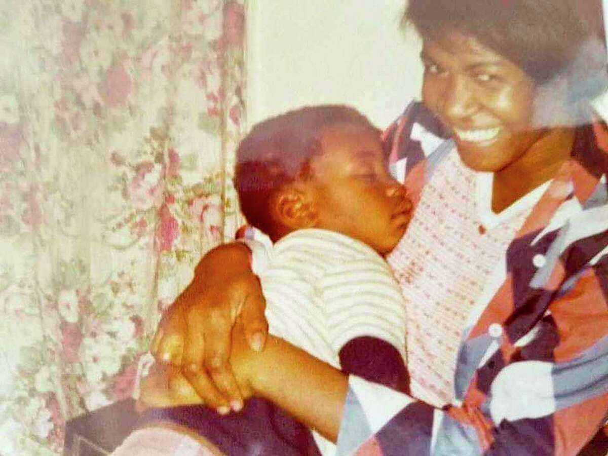 George Floyd as a boy with his mother.