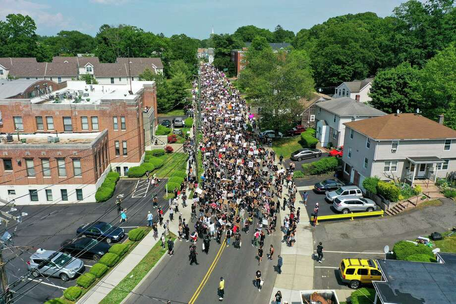 Protesters rally against police brutality in West Haven, Conn., on Saturday, June 6, 2020.