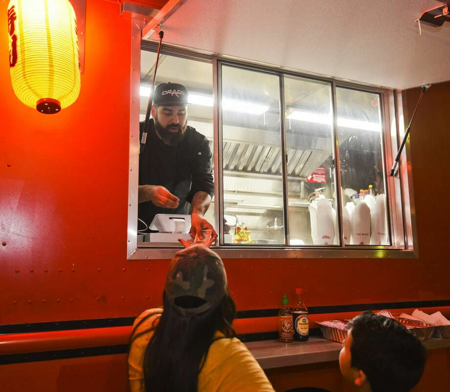 Customers order at Wok-A-Mole food truck on, Friday, Feb. 15, 2019, at Cultura Beer Garden. Owner Steven Salas is featured as the Entrepreneur of the Week. Photo: Danny Zaragoza/Laredo Morning Times / Laredo Morning Times