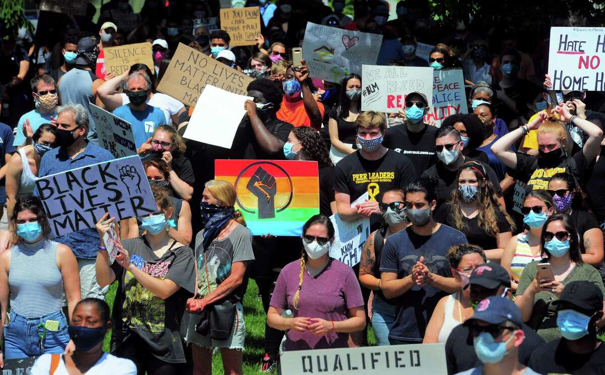 Over 1,000 people gathered to protest police brutality and hear calls for peace among deepening racial tensions in the aftermath of the death of George Floyd in police custody in Minneapolis during a rally held on the Trumbull Green in Trumbull, Conn., on Saturday, June 5, 2020.