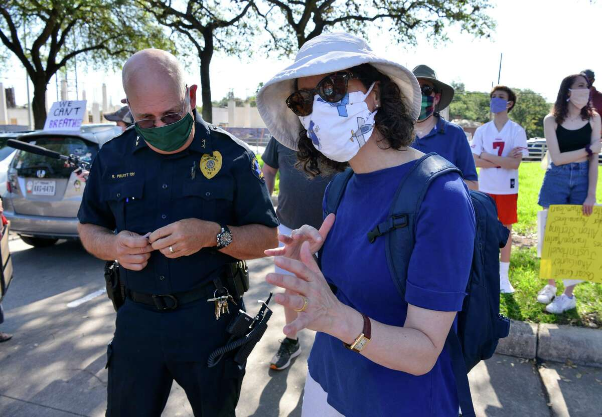 Protest organizer Claudia Stokes talks with Alamo Heights Police Chief Rick Pruitt prior to a Black Lives Matters march through Alamo Heights Saturday morning.