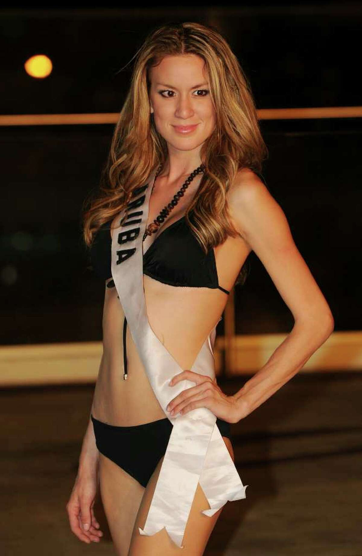 Miss Aruba Priscilla Lee poses for photographers during the Miss Universe 2010 Contestant Swimsuit Event at the Mandalay Bay Hotel in Las Vegas on August 21, 2010. The finals of the Miss Universe 2010 competition that will be held at the hotel on August 23. AFP PHOTO/Mark RALSTON