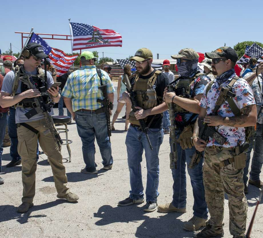 Open Carry Texas members protest on Saturday, June 6, 2020 at Big Daddy Zanes in West Odessa. Photo: Jacy Lewis/Reporter-Telegram / Jacy Lewis/Reporter-Telegram