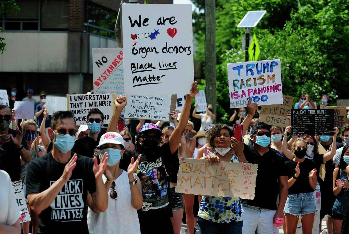 """Some of the 600 protesters chant """"No Justice, No Peace"""" during a rally outside of the Greenwich Town Hall to protest the death of George Floyd on June 6, 2020 in Greenwich, Connecticut."""
