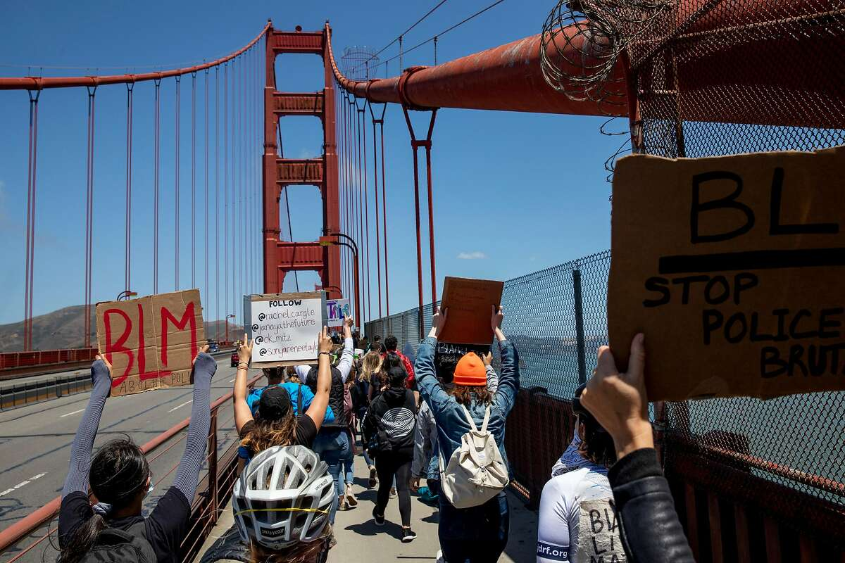 Thousands of demonstrators make their way across the Golden Gate Bridge in San Francisco, Calif. Saturday, June 6, 2020 during a march in support of the Black Lives Matter movement.