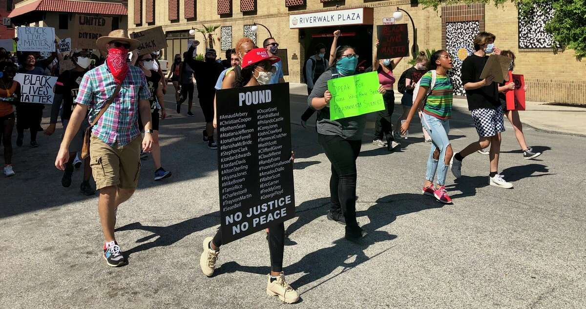 Protesters march from SAPD headquarters around the courthouse and back, shouting the names of black men and women who died in police custody on Saturday afternoon, June 6, 2020.