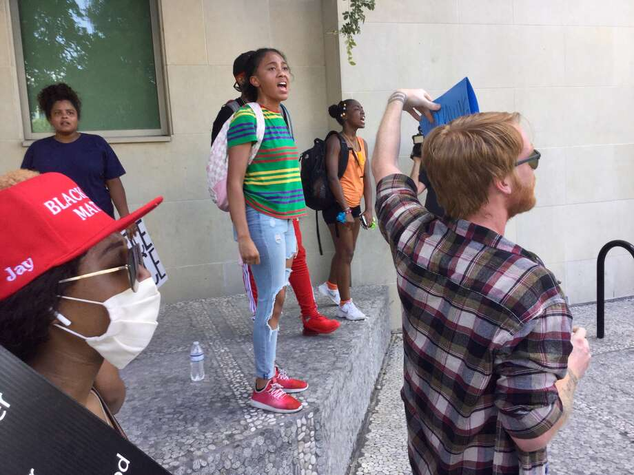 Protesters shout for justice and police reform outside of SAPD headquarters on Saturday afternoon, June 6, 2020.