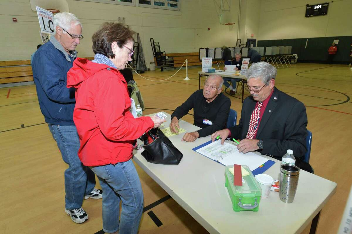 Norwalk residents head to the polls to vote on election day, Tuesday November 7, 2017.