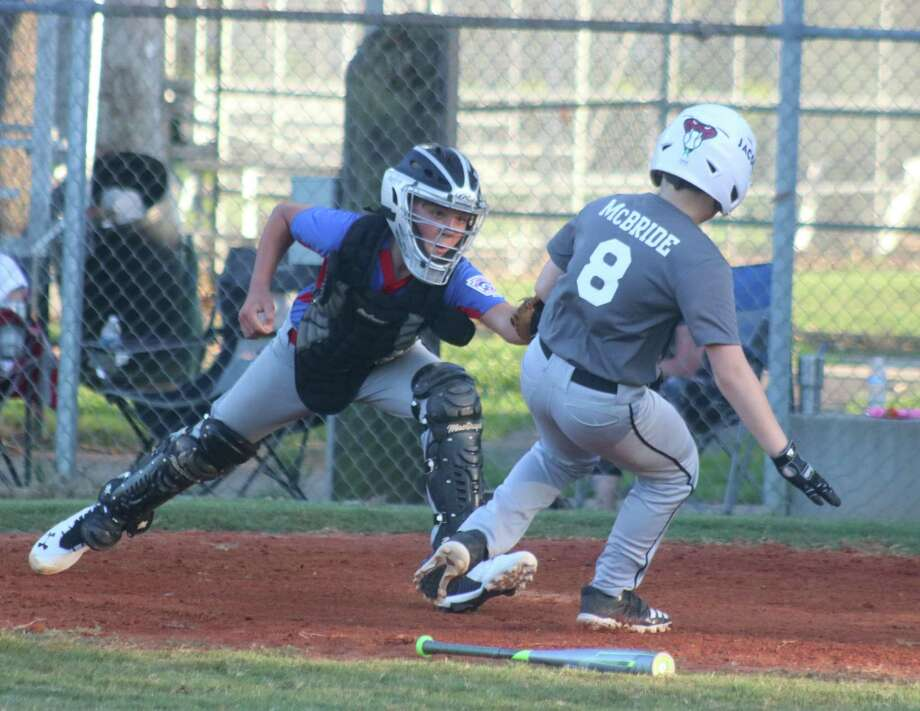Diamondbacks runner Jacob McBride gets tagged out at home plate during Friday night's scrimmage after he tried to score on a basehit. Photo: Robert Avery