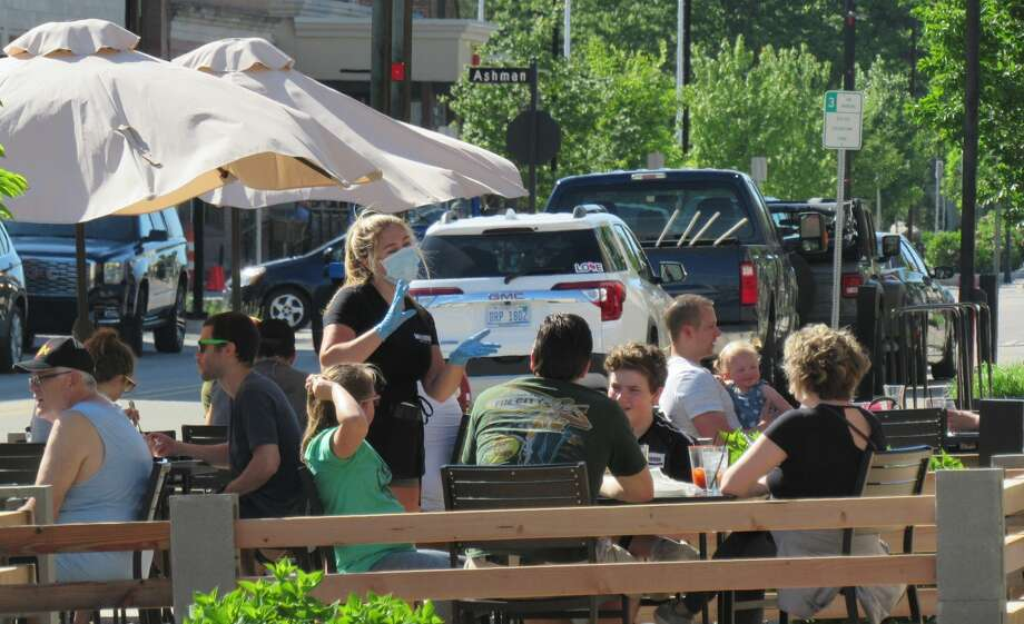 After nearly three months of staying home and social distancing, many Midland residents enjoyed the brisk and sunny weather in downtown Midland on June 6, 2020. (Mitchell Kukulka/Mitchell.Kukulka@mdn.net) Photo: Mitchell Kukulka