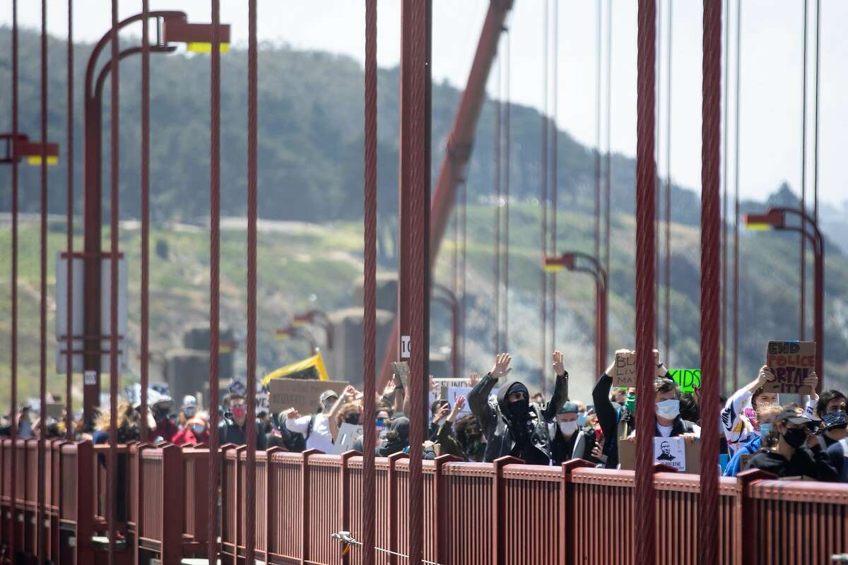 Thousands of demonstrators make their way across the Golden Gate Bridge in San Francisco, Calif. Saturday, June 6, 2020 during a march in support of the Black Lives Matter movement. A protest march closed some lanes of the Golden Gate Bridge Monday.