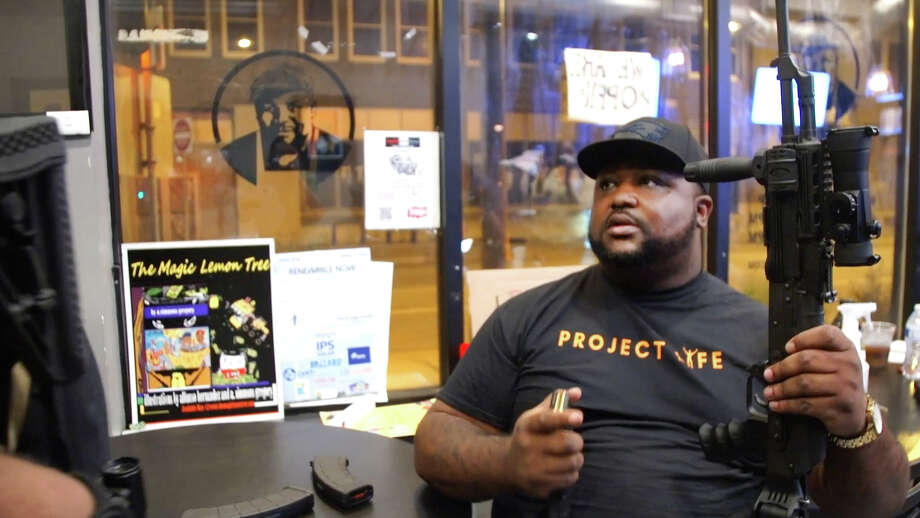"Tyrone Hartwell at Sammy's Avenue Eatery, which serves as headquarters for a citizen patrol group. ""We are a peaceful group . . . . We are brothers that banded together to protect our neighborhood."" Photo: Washington Post Photo By Jon Gerberg / The Washington Post"