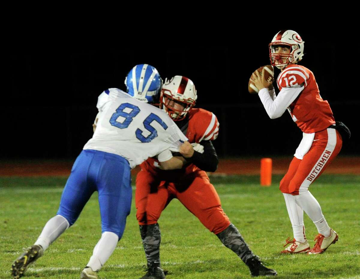 Guilderland quarterback George Marinopoulos (12) throws a pass against Shaker during their Section II Class AA high school semifinal football game in Guilderland, N.Y., Friday, Oct. 28, 2016. (Hans Pennink / Special to the Times Union) ORG XMIT: HP105