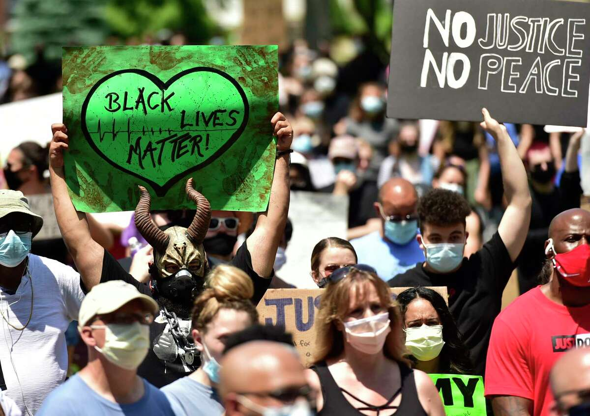 West Haven, Connecticut - Saturday, June 6, 2020: Approximately 675 demonstrators rallied Saturday afternoon on the West Haven Green and marched to the West Haven Police Department protesting police brutality including the death of Mubarak Soulemane of New Haven who was fatally shot by Connecticut StateTrooper Brian North just off Interstate 95?•s Exit 43 in West Haven on January 15, 2020. Soulemane allegedly had carjacked a driver in Norwalk following an alleged incident with a knife at a store there, then fled from police at high rates of speed along the highway.