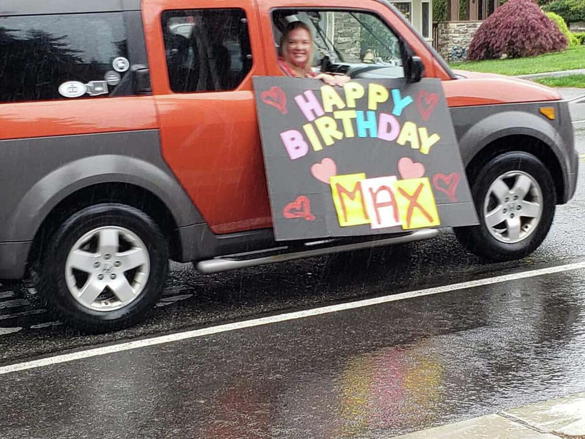 Lisa and her husband contacted a few of their friends and pitched the idea of a birthday car parade for Max. What they thought would be a small parade with close family and friends turned out to be an 80-car long parade that included his principal, his football coach, the local fire department, a medic truck, as well as dozens of his friends and family members.