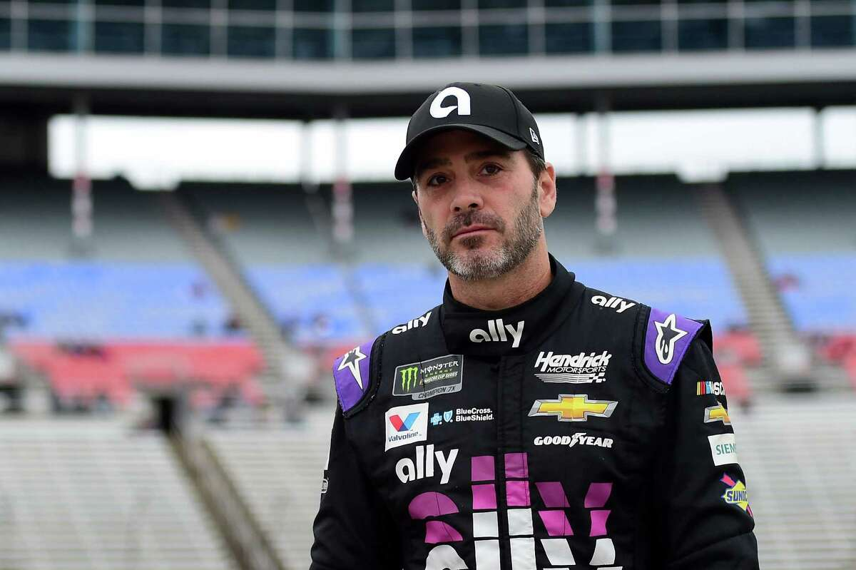 FORT WORTH, TX - MARCH 29: Jimmie Johnson, driver of the #48 Ally Chevrolet, walks on the grid during qualifying for the Monster Energy NASCAR Cup Series O'Reilly Auto Parts 500 at Texas Motor Speedway on March 29, 2019 in Fort Worth, Texas. (Photo by Jared C. Tilton/Getty Images)