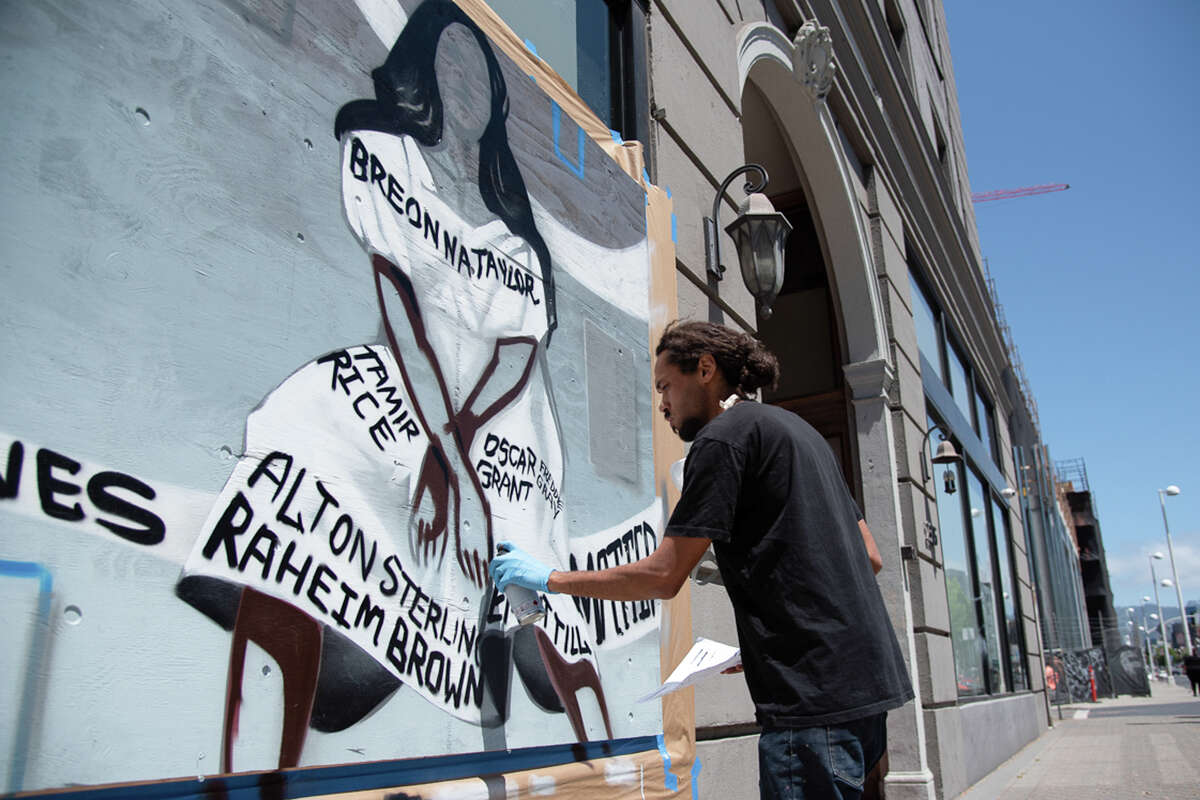 She eventually decided to board up the windows at the urging of her daughter, the co-owner of her business, but she agreed under one condition. She would hire a black artist to make the boards beautiful and commemorate the black lives lost to police brutality. The mural by artist Elijah Pfotenhauer spans multiple windows and lists the names of black lives lost, including George Floyd, Ahmaud Arbery and Breonna Taylor.